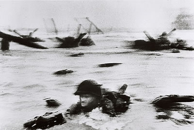 Robert Capa, American soldier landing on Omaha Beach, D-day, June 1944 © Cornell Capa